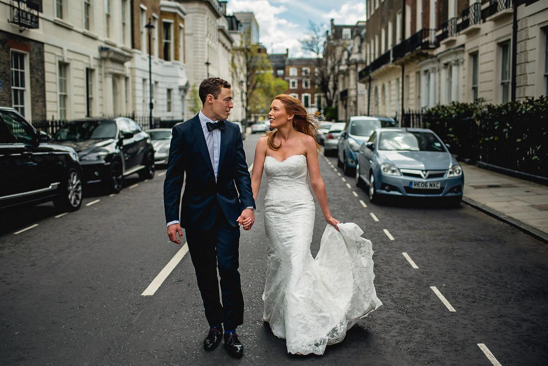 Bride & Groom walking hand in hand Asia House Wedding London