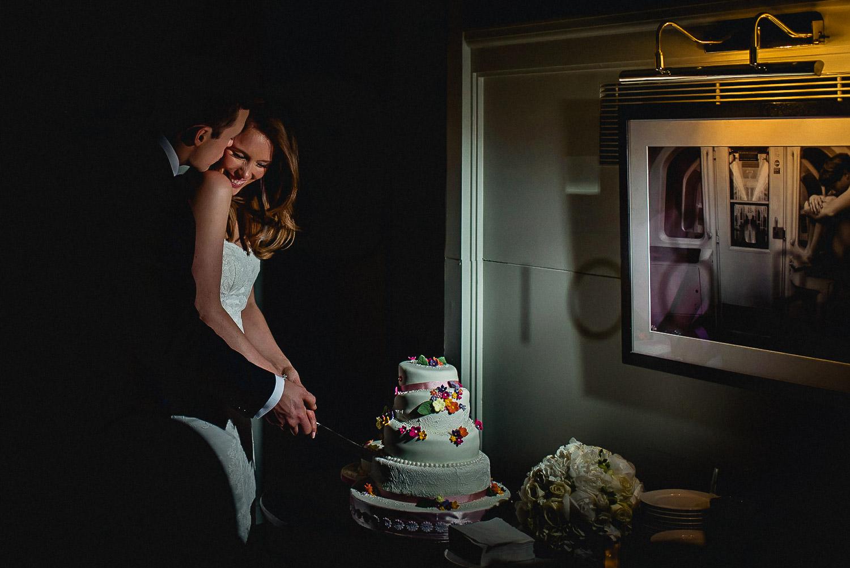 Bride & Groom cutting Wedding Cake at Asia House Wedding